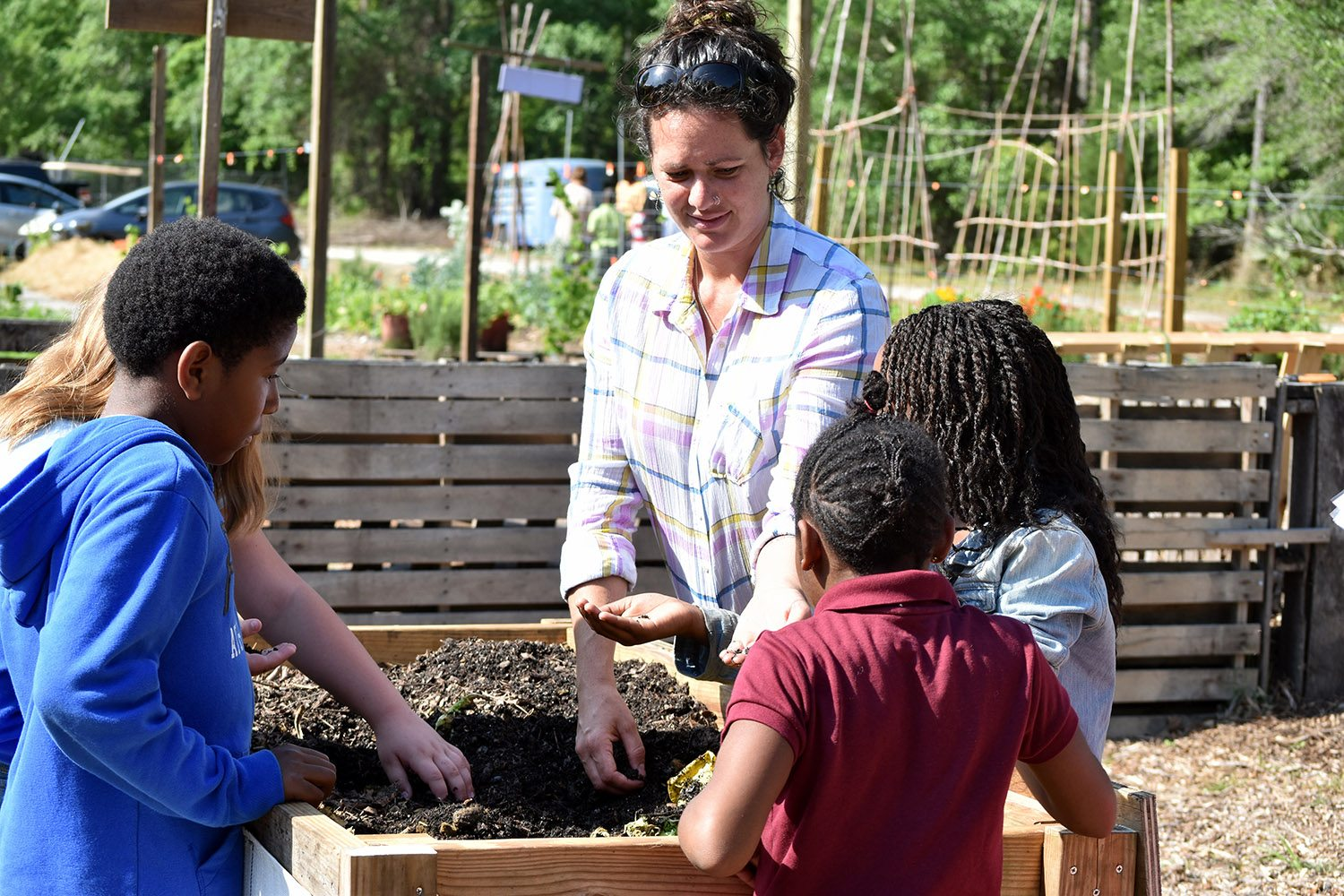 Students learn about how worms help gardens.